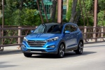 Picture of a driving 2016 Hyundai Tucson Limited 1.6T AWD in Caribbean Blue from a front left perspective