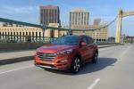 2017 Hyundai Tucson Limited 1.6T AWD in Sedona Sunset - Driving Front Left View