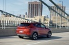 Driving 2018 Hyundai Tucson Limited 1.6T AWD in Sedona Sunset from a rear right three-quarter view