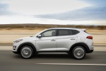 Picture of a driving 2019 Hyundai Tucson in Molten Silver from a left side perspective