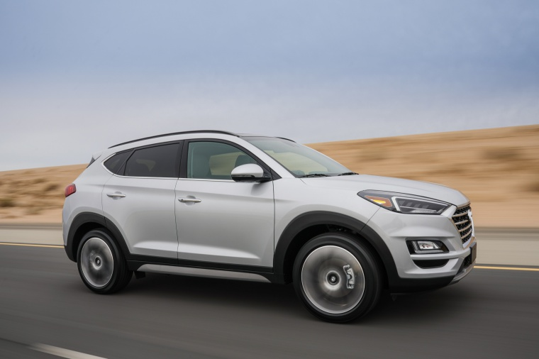 Picture of a driving 2020 Hyundai Tucson in Silver from a front right three-quarter perspective