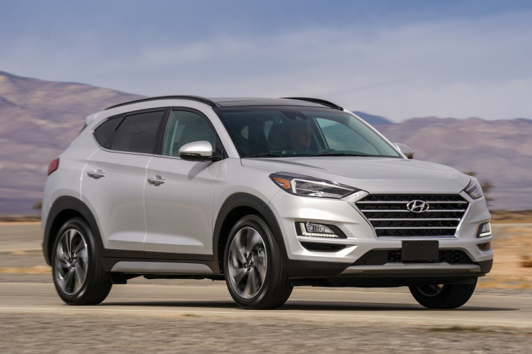 Picture of a driving 2020 Hyundai Tucson in Silver from a front right perspective