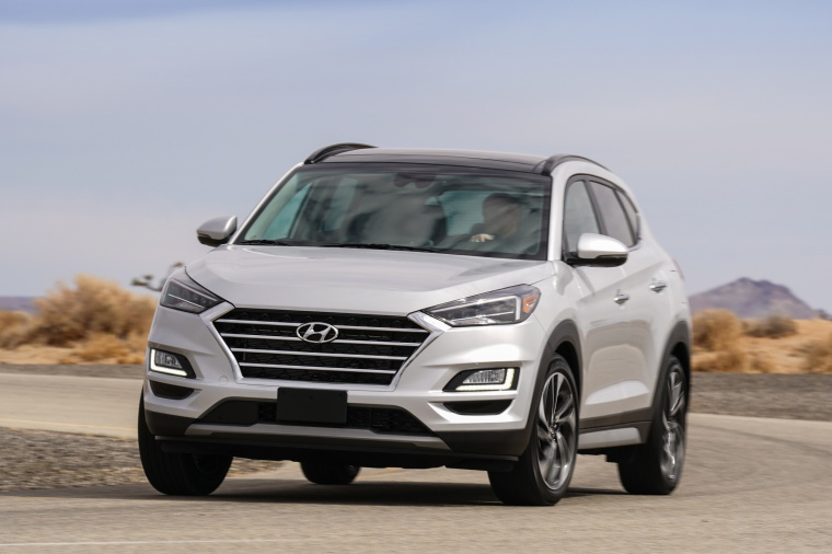 Picture of a driving 2020 Hyundai Tucson in Silver from a front left perspective