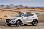 Picture of a driving 2020 Hyundai Tucson in Silver from a front left three-quarter perspective