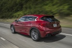 2018 Infiniti QX30S in Magnetic Red - Driving Rear Left Three-quarter View