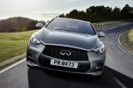 Picture of a driving 2019 Infiniti QX30 AWD in Graphite Shadow from a frontal perspective