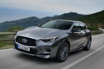 Picture of a driving 2019 Infiniti QX30 AWD in Graphite Shadow from a front left perspective