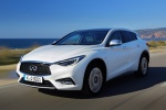 Picture of a driving 2019 Infiniti QX30 in Majestic White from a front left perspective