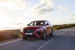 Picture of a driving 2019 Jaguar E-Pace P300 R-Dynamic AWD in Firenze Red Metallic from a front left perspective