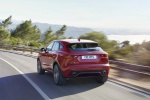 Picture of a driving 2019 Jaguar E-Pace P300 R-Dynamic AWD in Firenze Red Metallic from a rear left perspective