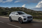 Picture of a driving 2019 Jaguar E-Pace P300 R-Dynamic AWD in Fuji White from a front right three-quarter perspective