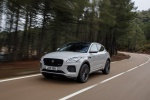 Picture of a driving 2019 Jaguar E-Pace P300 R-Dynamic AWD in Fuji White from a front left perspective