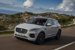 Picture of a driving 2019 Jaguar E-Pace P300 R-Dynamic AWD in Fuji White from a front left three-quarter perspective
