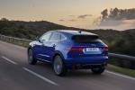 Picture of a driving 2019 Jaguar E-Pace P300 R-Dynamic AWD in Caesium Blue Metallic from a rear left perspective