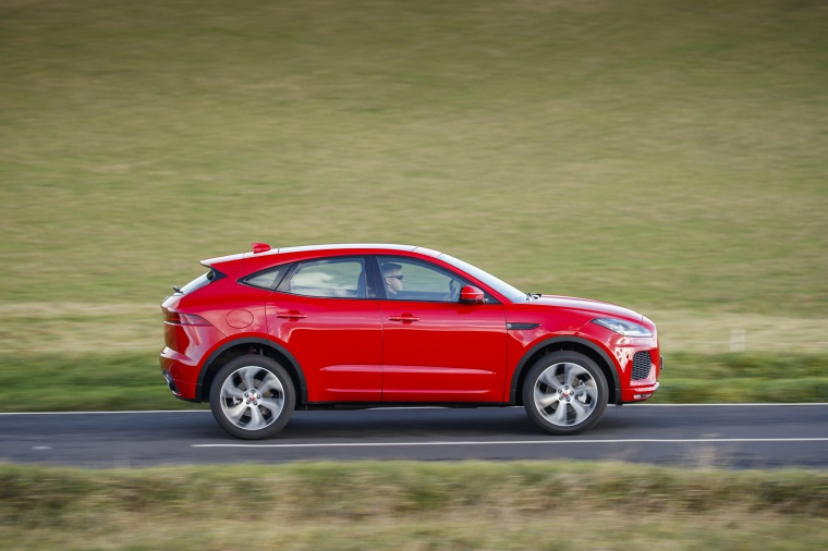 Driving 2020 Jaguar E-Pace P300 R-Dynamic AWD in Firenze Red Metallic from a right side view