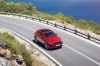 Driving 2020 Jaguar E-Pace P300 R-Dynamic AWD in Firenze Red Metallic from a front right view