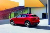 2020 Jaguar E-Pace P300 R-Dynamic AWD in Firenze Red Metallic from a rear left three-quarter view