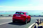 Picture of a driving 2020 Jaguar E-Pace P300 R-Dynamic AWD in Firenze Red Metallic from a rear right perspective