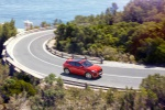 Picture of a driving 2020 Jaguar E-Pace P300 R-Dynamic AWD in Firenze Red Metallic from a front right three-quarter perspective