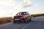 Picture of a driving 2020 Jaguar E-Pace P300 R-Dynamic AWD in Firenze Red Metallic from a front left perspective