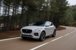 Picture of a driving 2020 Jaguar E-Pace P300 R-Dynamic AWD in Fuji White from a front left perspective