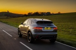 Picture of a driving 2020 Jaguar E-Pace P300 R-Dynamic AWD in Corris Gray from a rear perspective