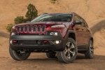Picture of a 2014 Jeep Cherokee Trailhawk 4WD in Deep Cherry Red Crystal Pearlcoat from a front left perspective