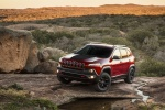 Picture of a 2014 Jeep Cherokee Trailhawk 4WD in Deep Cherry Red Crystal Pearlcoat from a front left three-quarter perspective