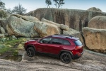 Picture of a 2014 Jeep Cherokee Trailhawk 4WD in Deep Cherry Red Crystal Pearlcoat from a side perspective