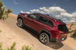 Picture of a 2015 Jeep Cherokee Trailhawk 4WD in Deep Cherry Red Crystal Pearlcoat from a rear left perspective
