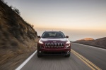Picture of a driving 2015 Jeep Cherokee Latitude in Deep Cherry Red Crystal Pearlcoat from a frontal perspective