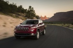 Picture of a driving 2015 Jeep Cherokee Latitude in Deep Cherry Red Crystal Pearlcoat from a front left perspective