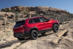 Picture of a 2015 Jeep Cherokee Trailhawk 4WD in Deep Cherry Red Crystal Pearlcoat from a rear right three-quarter perspective