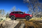 Picture of a 2015 Jeep Cherokee Trailhawk 4WD in Deep Cherry Red Crystal Pearlcoat from a side perspective