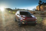 Picture of a 2015 Jeep Cherokee Trailhawk 4WD in Deep Cherry Red Crystal Pearlcoat from a front right perspective