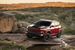 Picture of a 2015 Jeep Cherokee Trailhawk 4WD in Deep Cherry Red Crystal Pearlcoat from a front left three-quarter perspective