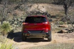 Picture of a 2015 Jeep Cherokee Trailhawk 4WD in Deep Cherry Red Crystal Pearlcoat from a rear perspective