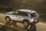 Picture of a 2015 Jeep Cherokee Limited 4WD in Billet Silver Metallic Clearcoat from a rear left three-quarter perspective