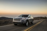 Picture of a driving 2015 Jeep Cherokee Limited 4WD in Billet Silver Metallic Clearcoat from a front left three-quarter perspective