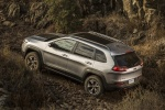 Picture of a 2015 Jeep Cherokee Trailhawk 4WD in Billet Silver Metallic Clearcoat from a rear left three-quarter perspective
