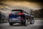 Picture of a 2015 Jeep Cherokee Limited 4WD in True Blue Pearlcoat from a rear right three-quarter perspective