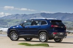 Picture of a 2015 Jeep Cherokee Limited 4WD in True Blue Pearlcoat from a rear left three-quarter perspective