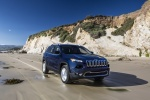Picture of a driving 2015 Jeep Cherokee Limited 4WD in True Blue Pearlcoat from a front right perspective