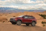 Picture of a 2016 Jeep Cherokee Trailhawk 4WD in Deep Cherry Red Crystal Pearlcoat from a front left three-quarter perspective