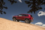 Picture of a 2016 Jeep Cherokee Trailhawk 4WD in Deep Cherry Red Crystal Pearlcoat from a rear left three-quarter perspective