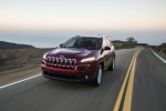 Picture of a driving 2016 Jeep Cherokee Latitude in Deep Cherry Red Crystal Pearlcoat from a front left three-quarter perspective