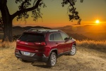 Picture of a 2016 Jeep Cherokee Latitude in Deep Cherry Red Crystal Pearlcoat from a rear right perspective
