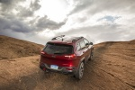 Picture of a 2016 Jeep Cherokee Trailhawk 4WD in Deep Cherry Red Crystal Pearlcoat from a rear right perspective