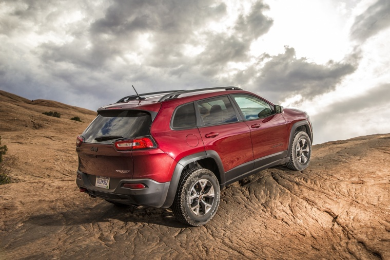 2017 Jeep Cherokee Trailhawk 4WD in Deep Cherry Red Crystal Pearlcoat from a rear right three-quarter view