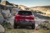 Picture of a 2017 Jeep Cherokee Trailhawk 4WD in Deep Cherry Red Crystal Pearlcoat from a rear perspective